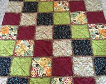 Green, red, and brown rag quilt throw