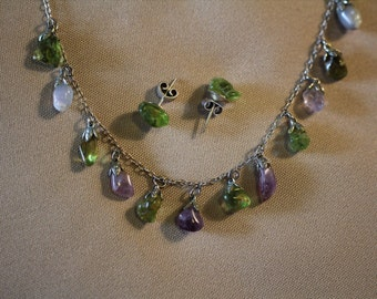 Amethyst and peridot gemstones  on a silver necklace with matching peridot errings
