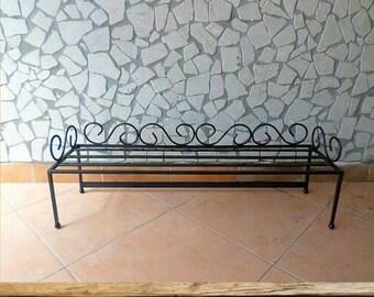 Wrought iron shelf door planter plants