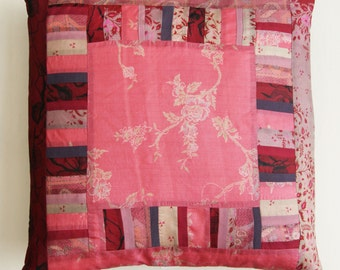 Pink floral patchwork silk cushion