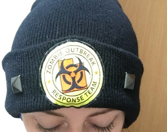 Zombie Outbreak Response Team studded black beanie hat. One size.