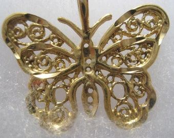 Gold Tone butterfly pendant