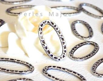 Lot de 10 anneaux fermés ovales en métal frappé couleur argent antique