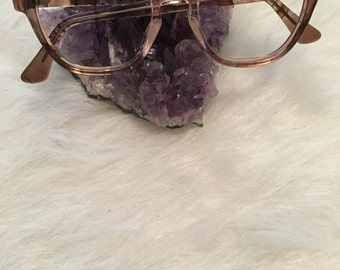 Brown and clear glasses frames