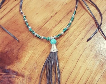 Leather tastle necklace.
