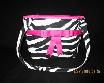Zebra print purse with a ribbon and bow