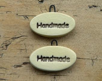 Ceramic charms 'handmade'
