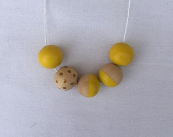 Wooden bead necklace // yellow with gold spots