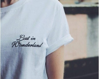 Lost in wonderland embroidered in black on white t-shirt