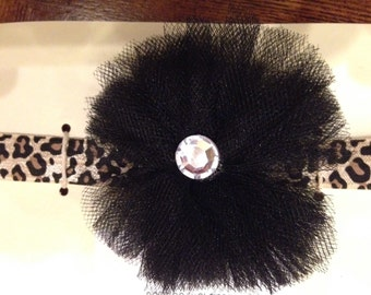 Black flower with cheetah headband