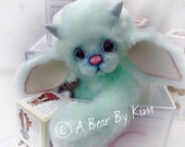 Stunning silky soft luxury synthetic fur in pastel mint green
