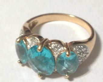 Beautiful gold tone sterling silver blue stone ring size 8