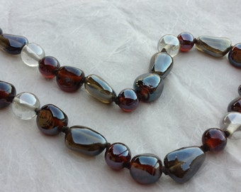 Necklace with glass pearls and transparent Brown