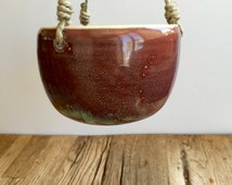 Red/purple and green ceramic hanging planter for indoor or outdoor ready to gift or use.