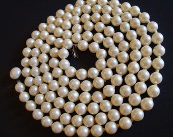 Vintage Faux Pearls Opera Length Knotted Necklace.