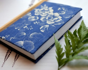 Notebook. Blue with white flowers.