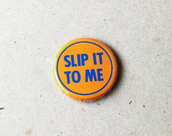 A Slip It To Me Pin Badge