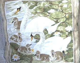 Swans and cygnets among the lilies cushion