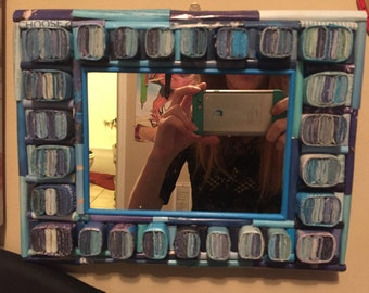 rolled paper mirror