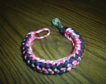paracord bracelets, assorted colors and designs.