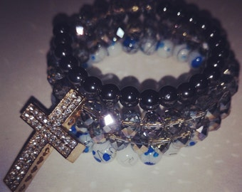 Decadent crystal bead  memory wire bracelet with cross