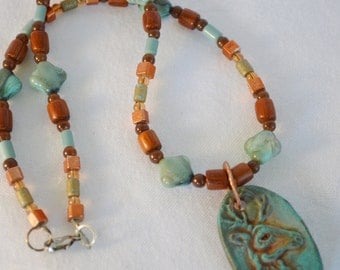 Southwestern Colors Beaded Necklace With Handmade Buck Pendant