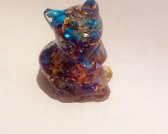 Orgonite cat sitting inlaid turquoise