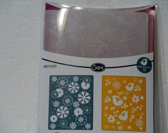 A set of two embossing folders by Cuddle Bug