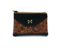 Lovely cork pouch with metallic bow