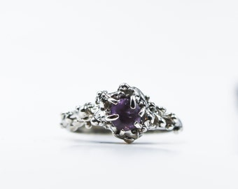 Sterling silver and purple garnet solitaire ring