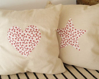 Ivory cushion with red and white heart applique