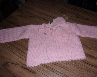 pink sweater and booties
