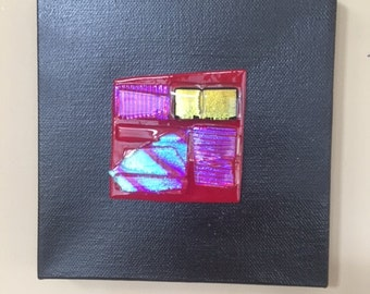 Abstract fused dichroic glass on red