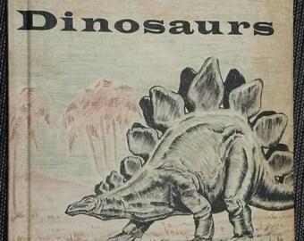 Dinosaurs, a book to begin on, by Eunice Holsaert and Robert Gartland. Hardcover, 1959