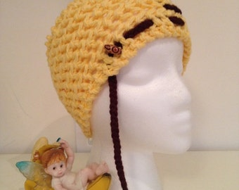 Knitted yellow headwarmer