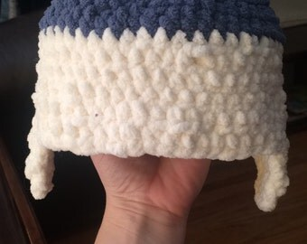 Crocheted beanie hat with ear muffs