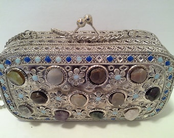Stone inlaid metal purse, from India