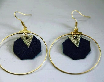 Pair of earrings, gold rings, and piece of leather