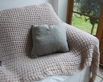 Beige crochet throw