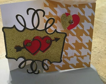 Gold valentine and matching envelope.
