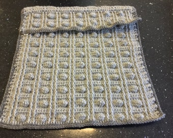 Gorgeous grey baby pushchair bobble blanket with flap.