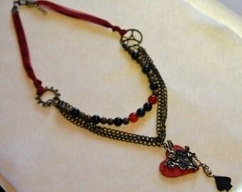 white rabbit bronze, ribbon, and glass necklace alice in wonderland