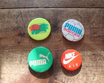 Retro sports brand pin badges