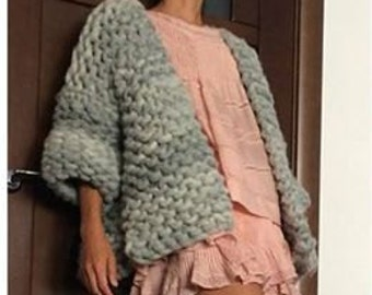 Knitted coat from giant 100% cotton yarn.