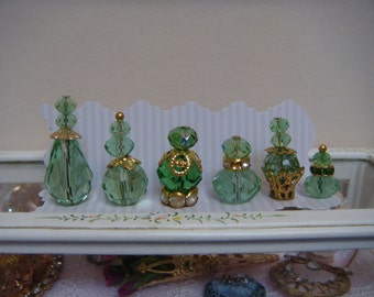 6 beautiful green crystal perfume bottles for your dolls house.