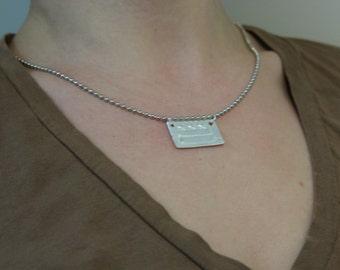 DC necklace