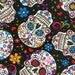 Black Folkloric Skulls by David Textiles sugar skull flowers floral day of the dead woven cotton by the yard metre