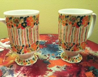 Two Colorful Retro Royal Crown Smug Mugs Tall Footed Hippy Flower and Stripes Pinstripes Rainbow