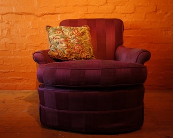 Pair of large comfortable arm chairs upolstered in rich fabric