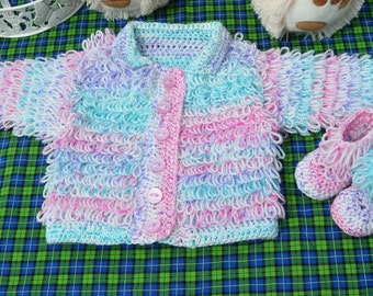 hand crocheted jacket and bootee set. 3-6 months